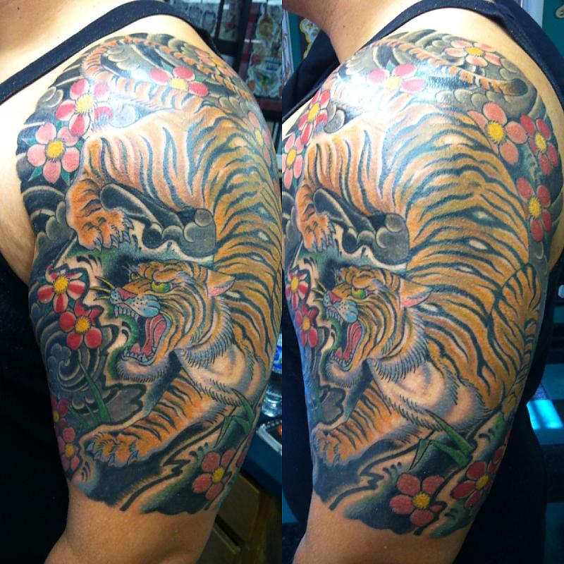 Asian Blossoms And Tiger Tattoos On Half Sleeve