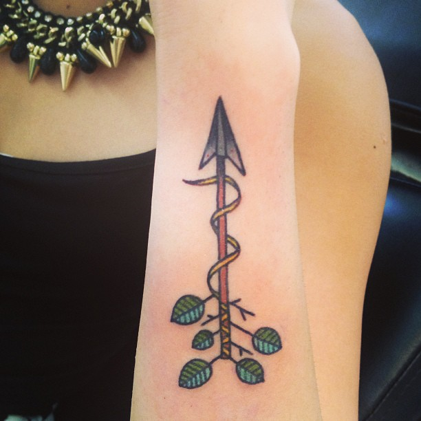 Attractive Arrow With Leaves Tattoo