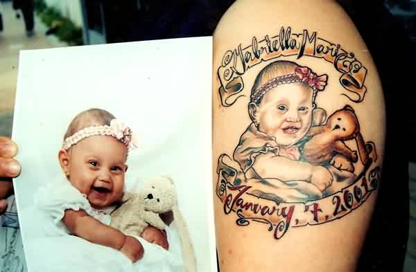 Attractive Baby Portrait Tattoo On Shoulder