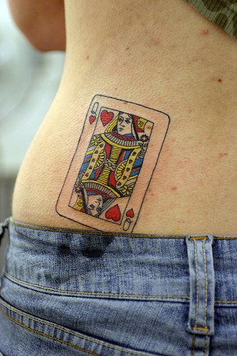 Attractive Queen Of Hearts Tattoo On Back Waist