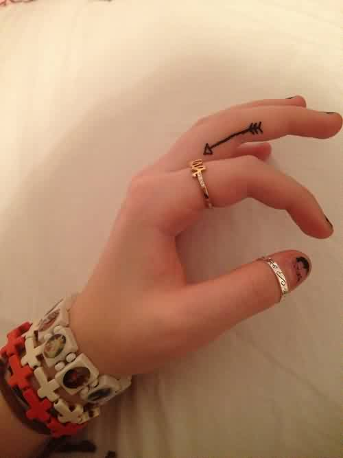 Attractive Thin Black Arrow Tattoo On Finger