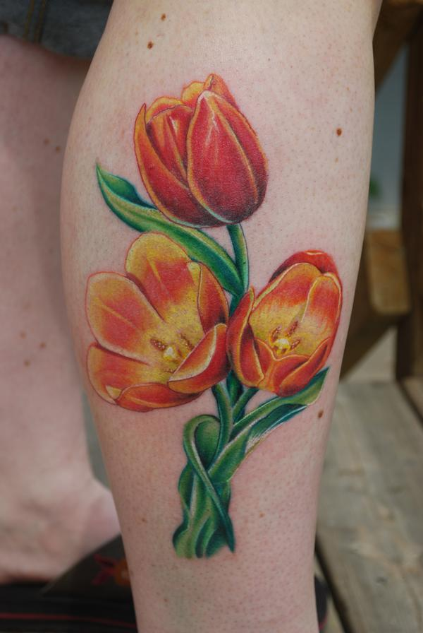 Attractive Tulips Tattoo On Leg