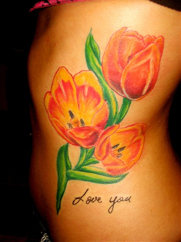 Attractive Tulips Tattoos On Ribs