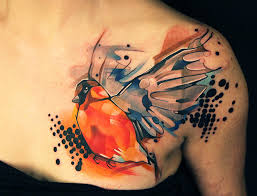 Attractive Watercolor Bird Tattoo On Chest
