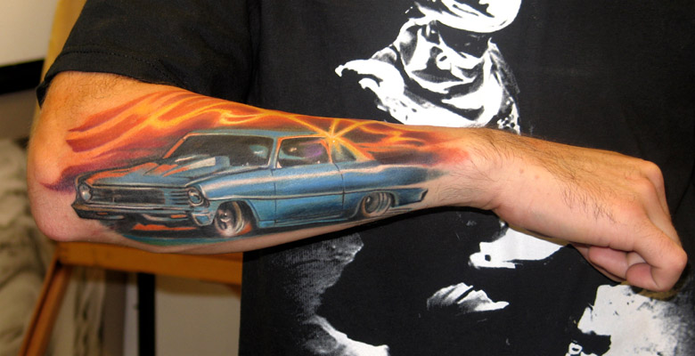 Awesome Blue Car Portrait Tattoo On Arm