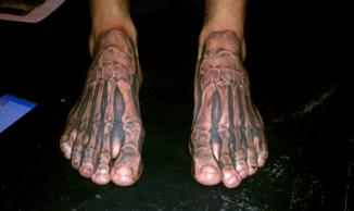 Awesome Bones Tattoo On Feet