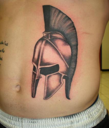 Awesome Helmet Tattoo On Stomach