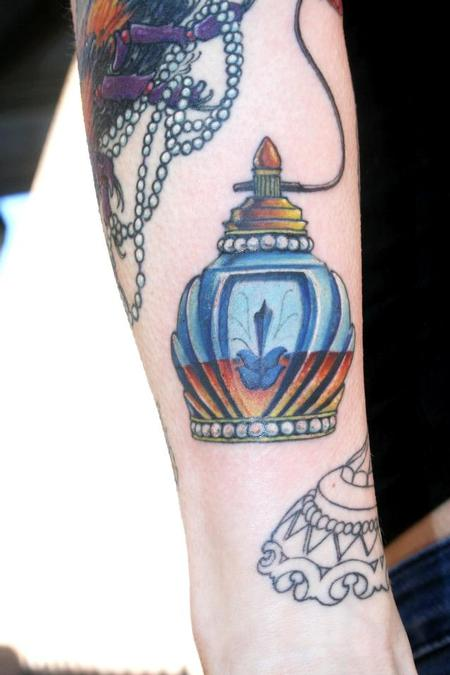 Awesome Perfume Bottle Tattoo On Arm