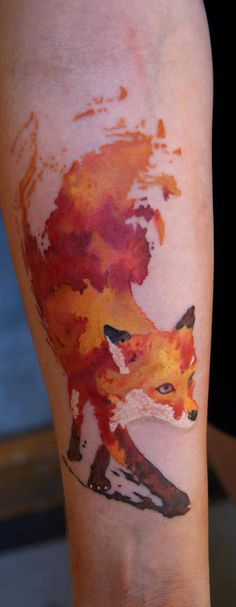 Awesome Watercolor Fox Tattoo On Forearm