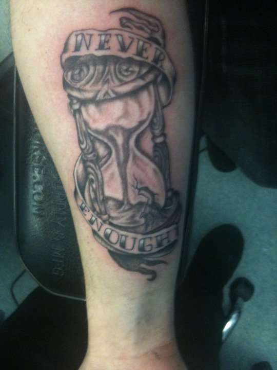 Banner And Grey Hour Glass Tattoos On Forearm