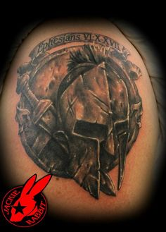 Banner Helmet And Weapon Tattoos On Shoulder