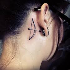 Beautiful Bow And Arrow Tattoo On Right Back Ear