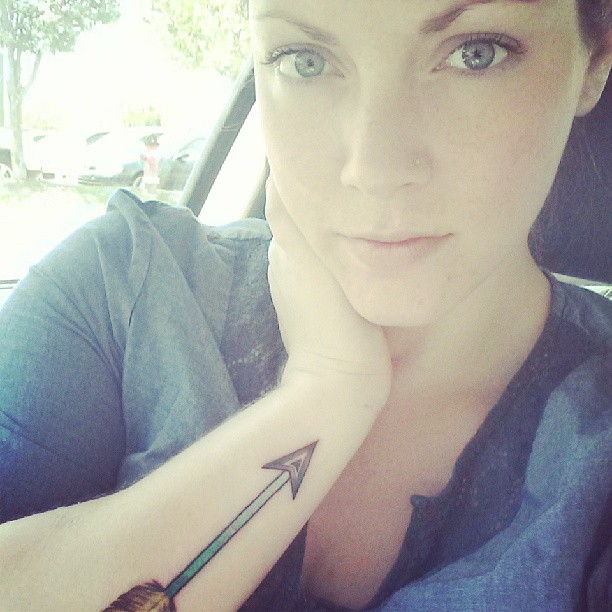 Beautiful Eyes And Arrow Tattoo On Wrist