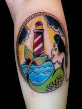 Beautiful Lighthouse And Mermaid Tattoos On Calf
