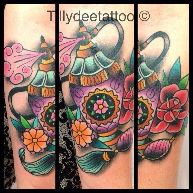 Beautiful Perfume Bottle Tattoo With Flowers