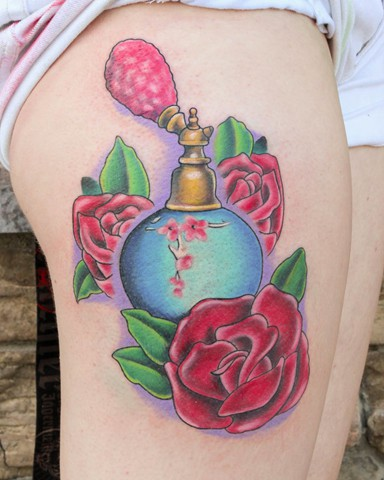 Beautiful Perfume Bottle With Flower Tattoos On Thigh