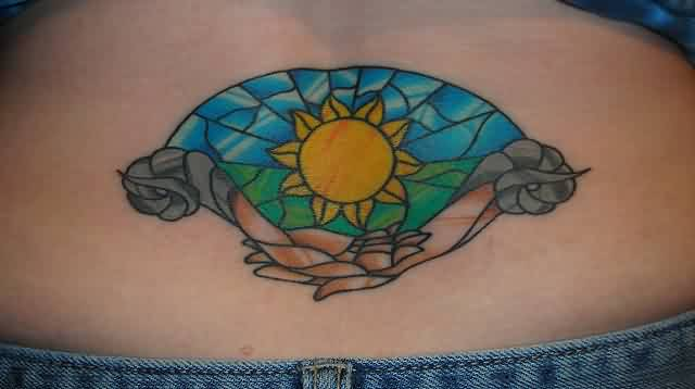 Beautiful Stain Glass Sun Tattoo On Lowerback