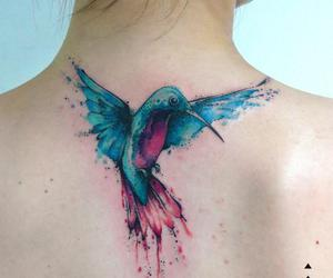 Beautiful Watercolor Bird Tattoo On Upperback