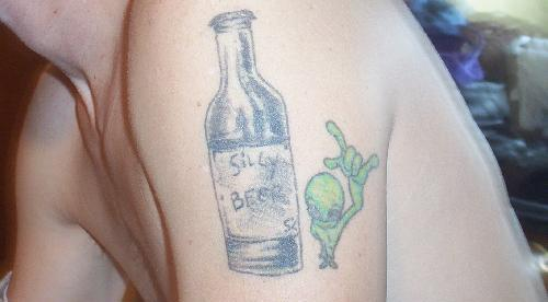 Beer Bottle And Alien Tattoos On Shoulder
