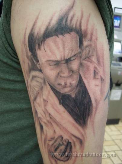 Bill Hicks Smoking Cigarette Portrait Tattoo On Biceps