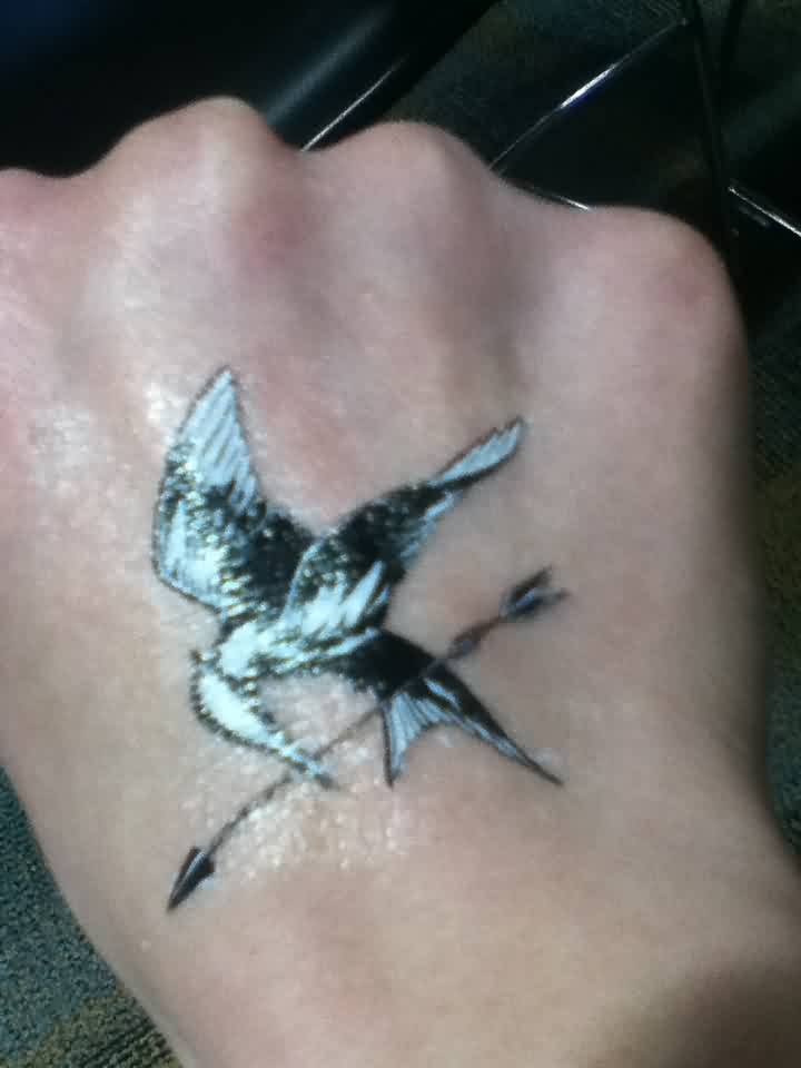 Bird With Arrow Temporary Tattoo On Hand