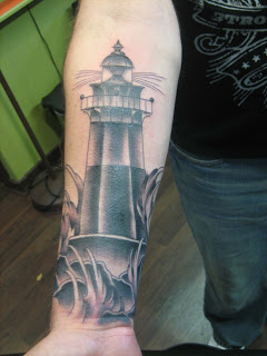Black And Grey Ink Lighthouse Tattoo On Forearm