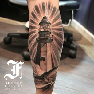 Black And Grey Ink Lighthouse Tattoo On Leg