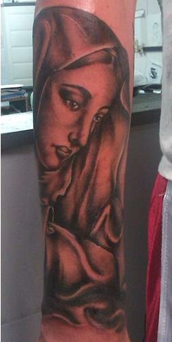 Black And Grey Ink Portrait Tattoo