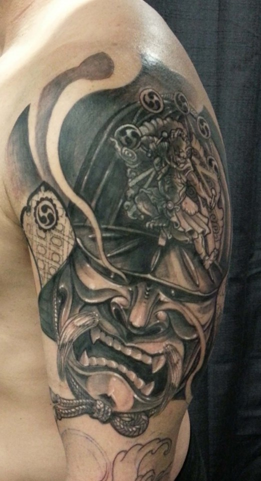 Black And Grey Samurai Helmet Tattoo On Half Sleeve