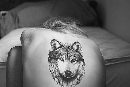 Black And White Animal Head Tattoo On Back
