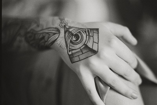 Black And White Eye Pyramid Tattoo On Hand