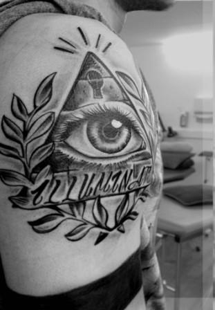 Black And White Eye Pyramid Tattoo On Shoulder