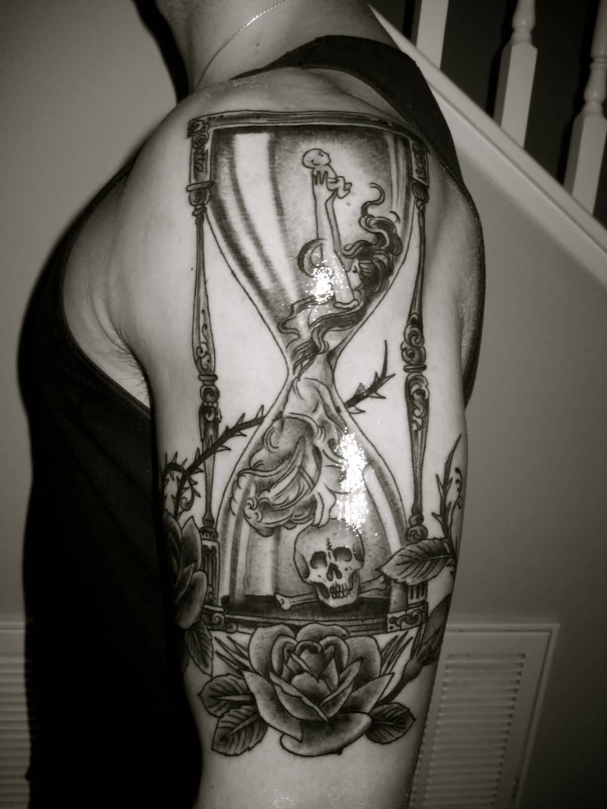Black And White Hourglass And Rose Tattoos On Biceps