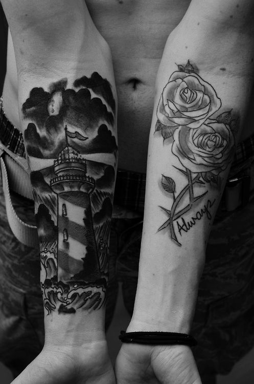 Black And White Lighthouse And Rose Tattoos On Forearms