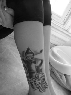 Black And White Lighthouse And Waves Tattoo