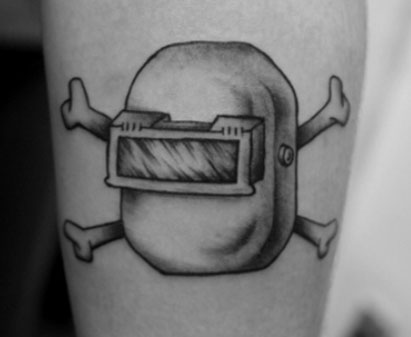 Black And White Welding Helmet And Crossed Bone Tattoos