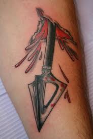 Black Arrow From Skin Tattoo
