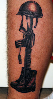Black Ink Fallen Soldier's Helmet On Gun Boot Tattoo