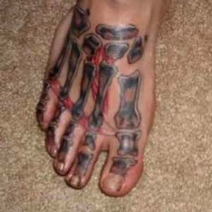 Black Ink Foot Bone Tattoo