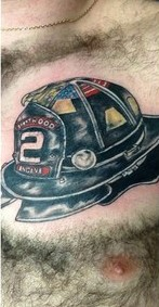 Black Ink Helmet Tattoo On Chest