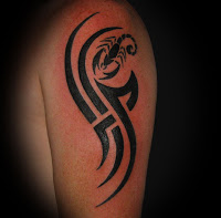 Black Ink Tribal And Scorpion Tattoos On Arm