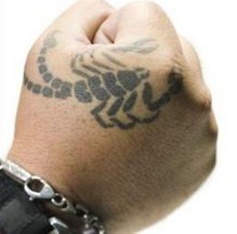 Black Scorpion Tattoo On Hand