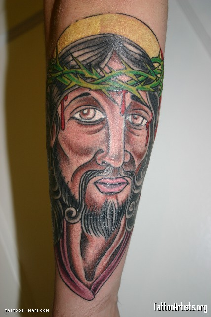 Bleeding Jesus Portrait Tattoo On Lower Arm