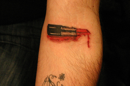 Bleeding Lipstick Tattoo On Arm
