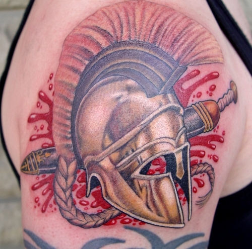 Blood And Roman Helmet Tattoos On Shoulder