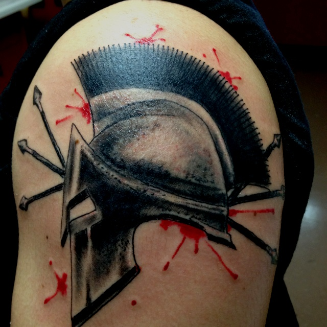 Blood And Spartan Helmet Tattoos On Shoulder