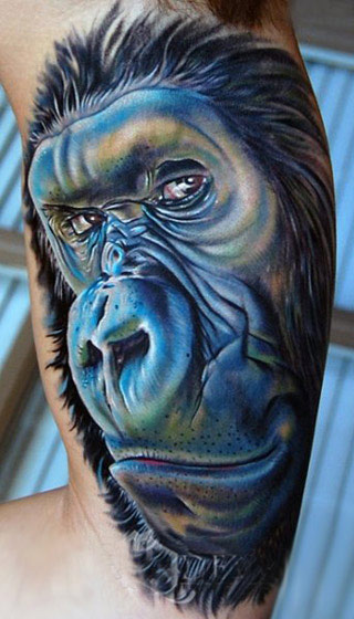Blue Animals Gorilla Portrait Tattoo On Muscles