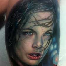 Blue Eyed Vampire Portrait Tattoo
