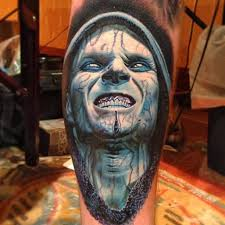 Blue Ink Angry Face Portrait Tattoo