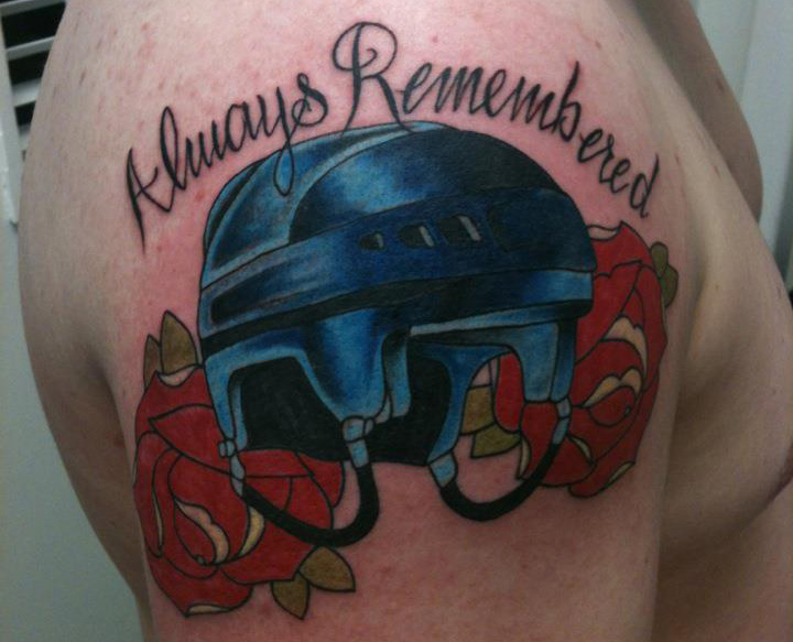 Blue Ink Helmet And Rose Tattoos On Shoulder